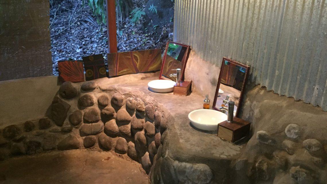 Outside bathroom for dorm in Montezuma Hostel for sale