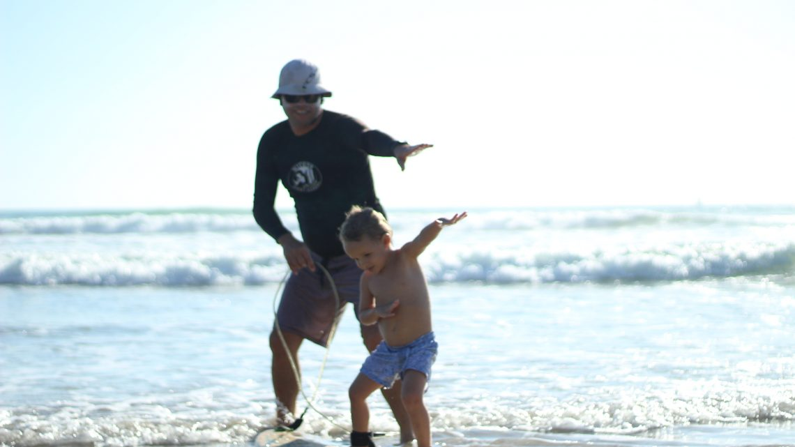 Learn to surf lesson for children in Montezuma best surf school with special surf program for kids and kids surf equippment