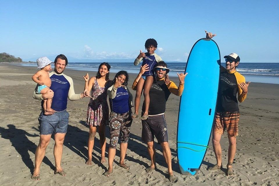 Learn to surf family lessons, special kid surf instructor and eqquipment and nanny