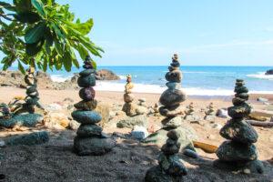 Towers of rocks at playa Piedra Colorada beach Montezuma Costa Rica