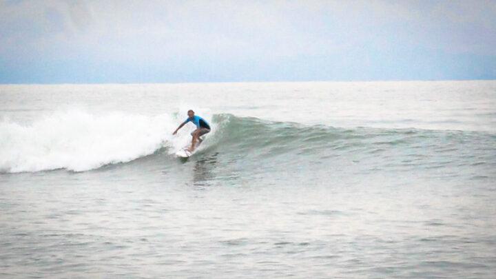 Surfer on a nice wave at playa los Cedros beach